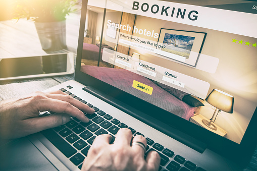 Man using hotel booking engine software